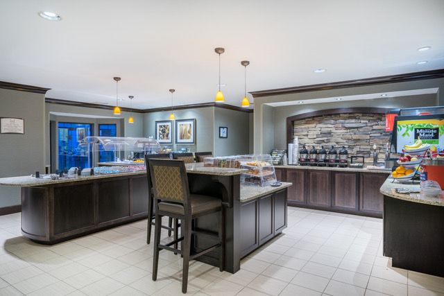 Staybridge Suites, Glen Mills, PA -Buffet Area - Chocolate Scheme renovation, stone wall, ceiling pendants
