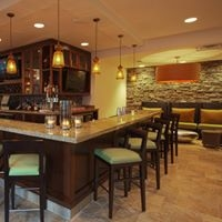 Hilton Garden Inn - Oaks, PA Lobby Bar pendant lighting, stone wall, bar stools