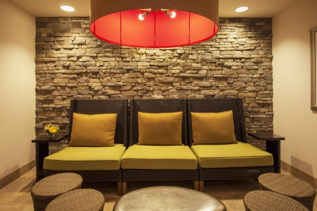 Hilton Garden Inn - Oaks, PA Seating Area Next to bar, stone wall,